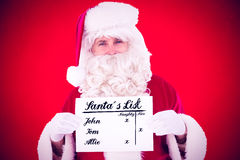 Composite image of smiling santa claus holding page. Smiling santa claus holding page against red background Royalty Free Stock Photo