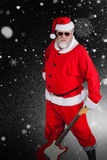 Composite image of smiling santa claus standing with guitar Royalty Free Stock Photos