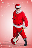 Composite image of smiling santa claus standing with guitar Stock Photography