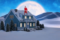 Composite image of smiling santa claus standing with guitar Royalty Free Stock Images