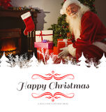 Composite image of smiling santa delivering gifts at christmas eve Stock Photo