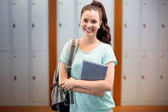 Composite image of smiling student. Smiling student against closed lockers in a row at the college Royalty Free Stock Photography