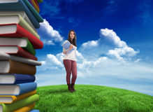 Composite image of smiling student holding textbook Stock Photography