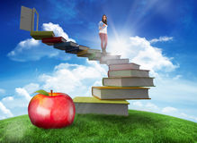 Composite image of smiling student holding textbook Royalty Free Stock Image