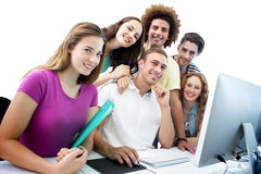 Composite image of smiling students in computer class Royalty Free Stock Photo
