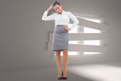 Composite image of smiling thoughtful businesswoman Royalty Free Stock Photo