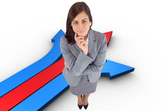 Composite image of smiling thoughtful businesswoman Royalty Free Stock Images