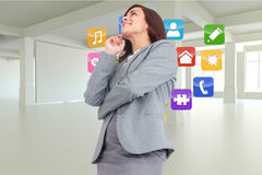 Composite image of smiling thoughtful businesswoman Stock Image
