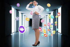 Composite image of smiling thoughtful businesswoman Stock Images