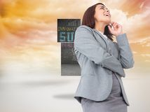 Composite image of smiling thoughtful businesswoman Stock Photos
