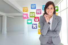 Composite image of smiling thoughtful businesswoman Stock Photography