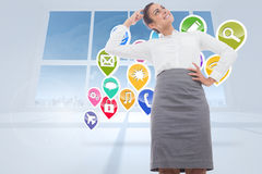 Composite image of smiling thoughtful businesswoman Royalty Free Stock Photography