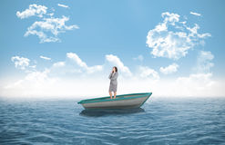 Composite image of smiling thoughtful businesswoman in a sailboat Stock Photography