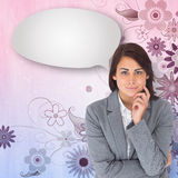 Composite image of smiling thoughtful businesswoman with speech bubble Stock Image