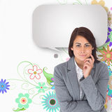 Composite image of smiling thoughtful businesswoman with speech bubble Stock Images