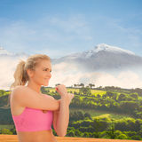 Composite image of smiling toned woman exercising on beach Royalty Free Stock Photos