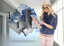 Composite image of smiling trendy blonde using tablet computer Stock Images