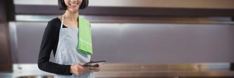 Composite image of smiling waitress holding digital tablet against white background stock images