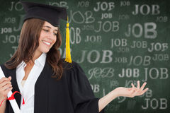 Composite image of a smiling woman with a degree as she opens out her other hand Stock Photos
