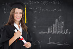 Composite image of a smiling woman with a degree in hand as she looks at the camera Stock Photography