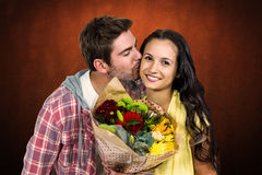 Composite image of smiling woman holding bouquet and being kissed by boyfriend Royalty Free Stock Photography