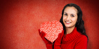 Composite image of smiling woman holding gift box Stock Image