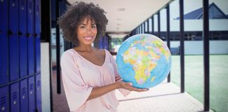 Composite image of smiling woman holding globe Royalty Free Stock Photography