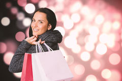 Composite image of smiling woman holding shopping bag Stock Photo