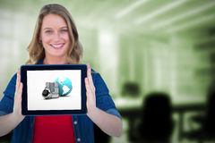 Composite image of smiling woman holding tablet pc Royalty Free Stock Photo
