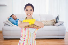 Composite image of smiling woman leaning on mop Stock Photos
