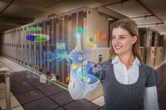 Composite image of smiling woman pointing something with her finger. Smiling woman pointing something with her finger against data center Stock Images