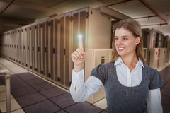 Composite image of smiling woman pointing something with her finger Royalty Free Stock Photos