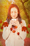 Composite image of smiling woman smelling hot beverage Royalty Free Stock Images