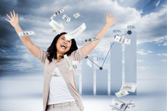 Composite image of smiling woman throwing money around Royalty Free Stock Photography