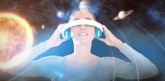 Composite image of smiling woman using virtual video glasses 3d Stock Photography