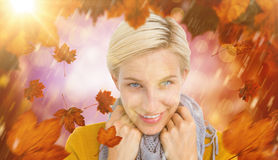 Composite image of smiling woman wearing a scarf Royalty Free Stock Photos