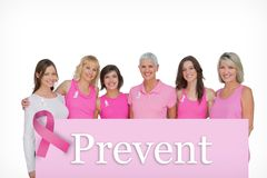 Composite image of smiling women wearing pink for breast cancer awareness Royalty Free Stock Image