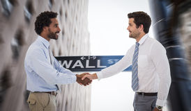 Composite image of smiling young businessmen shaking hands in office stock photos