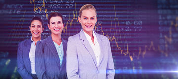 Composite image of smiling young businesswomen in a line Stock Photo