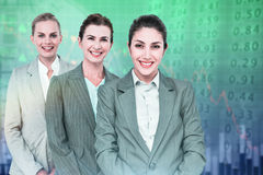 Composite image of smiling young businesswomen in a line Royalty Free Stock Photo