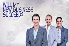 Composite image of smiling young businesswomen in a line Stock Photography