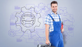 Composite image of smiling young male repairman carrying toolbox Royalty Free Stock Photography