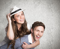Composite image of smiling young man carrying woman Royalty Free Stock Image
