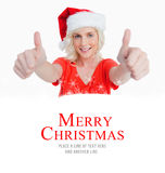 Composite image of smiling young woman putting her thumbs up in satisfaction. Smiling young woman putting her thumbs up in satisfaction against merry christmas Royalty Free Stock Photos