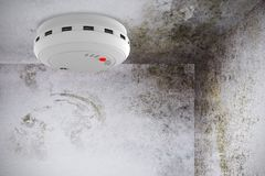 Composite image of smoke and fire detector. Smoke and fire detector against image of room corner Stock Photos