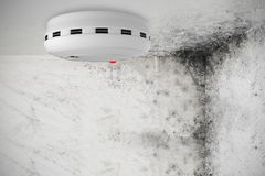 Composite image of smoke and fire detector. Smoke and fire detector against image of room corner Royalty Free Stock Images