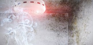 Composite image of smoke and fire detector. Smoke and fire detector against image of room corner Royalty Free Stock Photography
