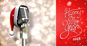 Composite image of snow falling. Snow falling against microphone with santa hat Stock Photos