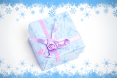 Composite image of snow flake frame in blue Stock Photo