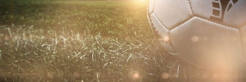 Composite image of soccer ball on white marking line royalty free stock photography